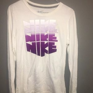 white nike with purple lettering long sleeve shirt